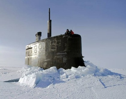 Submarine breaking through the ice